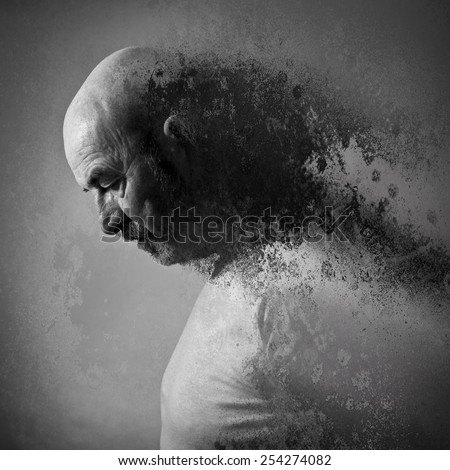 An old man with a grey beard in sorrow - stock photo
