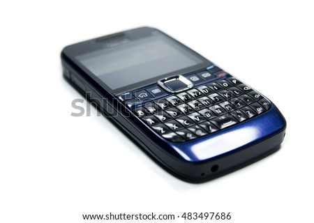 An old mobile phone with keyboard pad isolated on white background