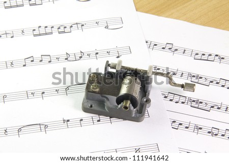an old music box on note sheets - stock photo