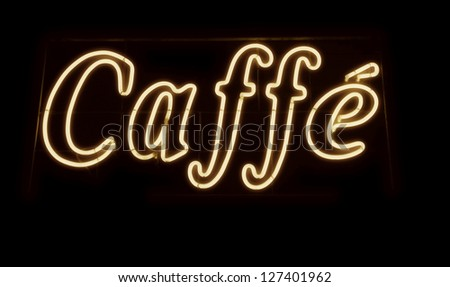 An old neon sign, Caffe. Sepia tones. Photograph. - stock photo
