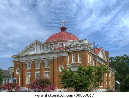 an old nice episcopal church with a dome