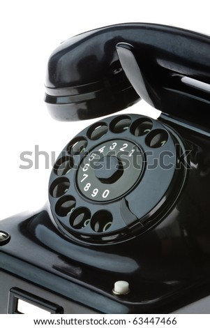 An old, old landline telephone. Phone on a white background. - stock photo