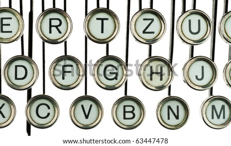 An old, old typewriter. Photographed on a white background. - stock photo