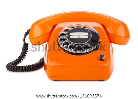 an old orange phone with rotary dial - stock photo