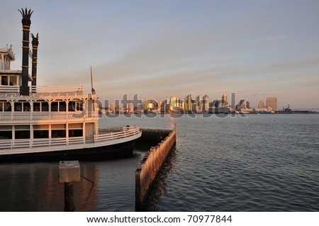 An old paddle wheel boat frames this view of San Diego. - stock photo