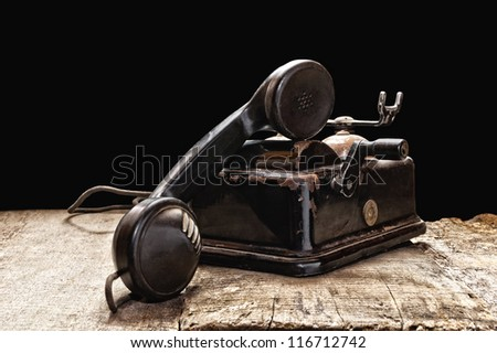An old phone in dusty and rusty condition. - stock photo