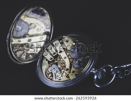 An old pocket watch. - stock photo