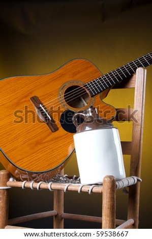 An Old Potter Ceramic Country Jug With A Guitar And Rope Bottom Chair On A  Gold