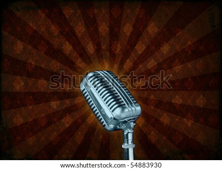 An old radio speaker on a grunge background - stock photo