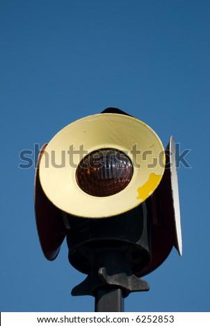 An old railroad signal light - stock photo