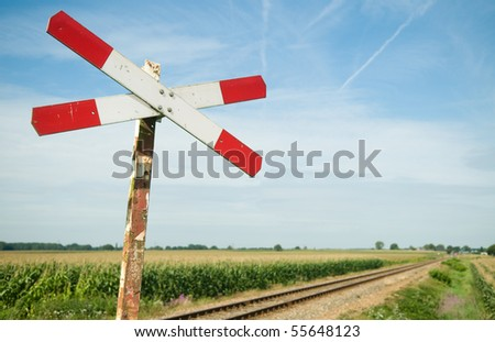 An old railway sign near a small railway in Holland, Netherlands. - stock photo