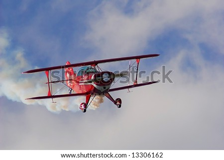 An old red biplane in air show . - stock photo