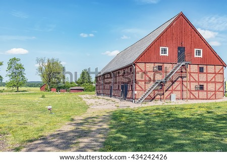 An old red brick barn set in the rural countryside of Swedens Halland region.