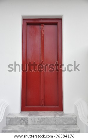 an old red door of a temple
