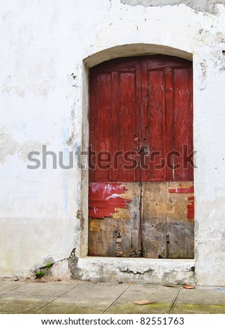 An old red painted wood door in El Salvador, Central America