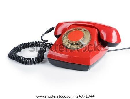 An old red phone on a white background