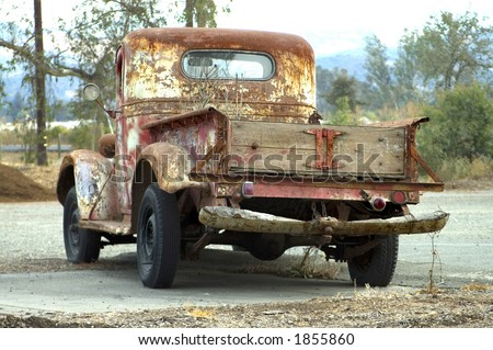 An old red truck. - stock photo