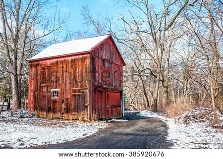 An old red wooden barn in rural Central New Jersey. - stock photo