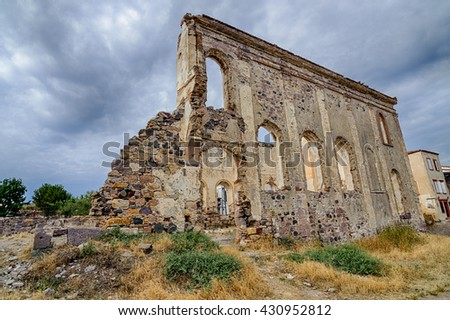 An old ruin greek church near by city library and windmill in Cunda Alibey Island.  It is a small island in the north Aegean Sea, off the coast of Ayvalik in Balikesir Turkey.