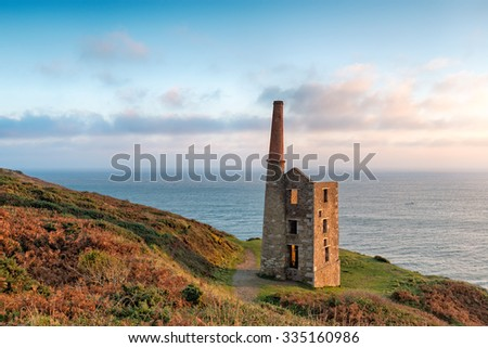 An old ruined Cornish engine house on cliffs at Rinsey Head near Helston in Cornwall