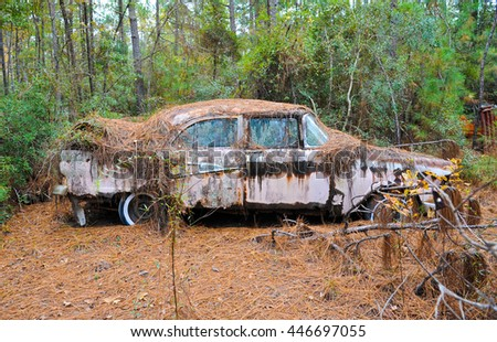 stock-photo-an-old-rusted-out-scrap-car-