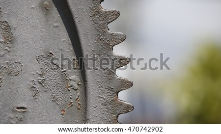 An old rusty gear close view with a generic bokeh background