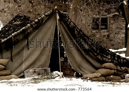 An old, sepia, and grainy WWII photo of a US Army mobile camp - stock photo