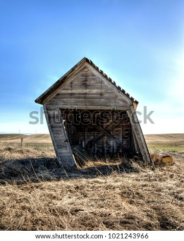 An old shed in eastern Washington is leaning a great deal.