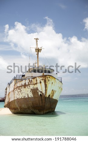 An old ship has run aground in the shallow near the Turks & Caicos Islands. - stock photo