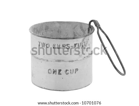 An old sifting cup dusty with flour isolated on a white background. Image is in black & white. Clipping path.