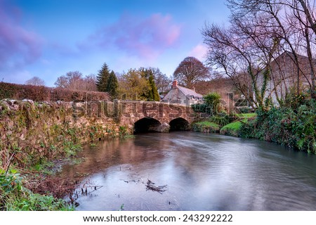 An old stone bridge over the river Lerryn at Couch's Mill near Lostwithiel in Cornwall - stock photo
