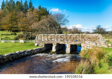 An old stone bridge over Walla Brook near Bellever on Dartmoor National Park in Devon - stock photo