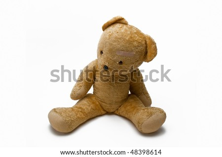 An Old Teddy Bear With Sticking Plaster Isolated On White Background - stock photo