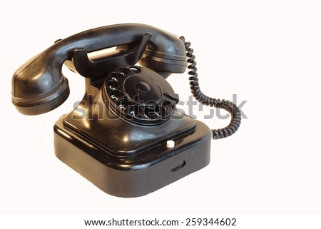 an old telephon with rotary dial / Old rotary phone on white background