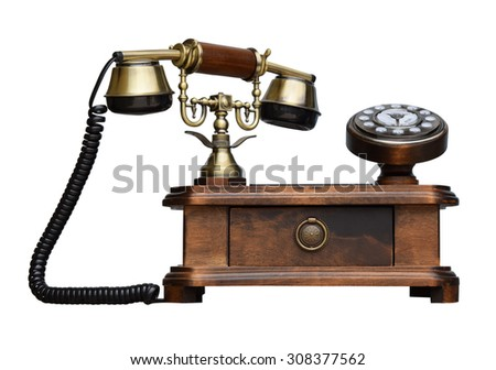 an old telephon with rotary dial on white background - stock photo