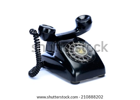 An old telephone with rotary dial