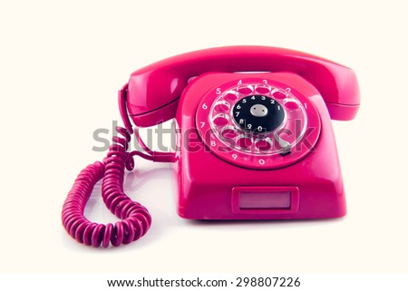 an old telephone with rotary dial color toned - stock photo