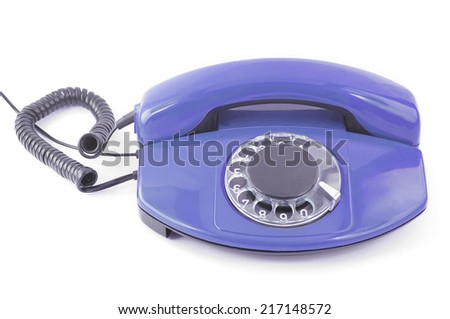 an old telephone with rotary dial isolated on white background. - stock photo