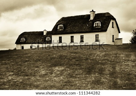 an old thatched house in a village in Ireland - stock photo