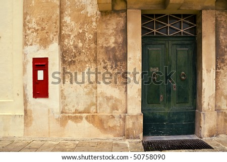 An old traditional doorway with a letter box outside. Vintage colouring added. - stock photo