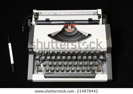 An Old Travel Vintage Typewriter on a Black Background