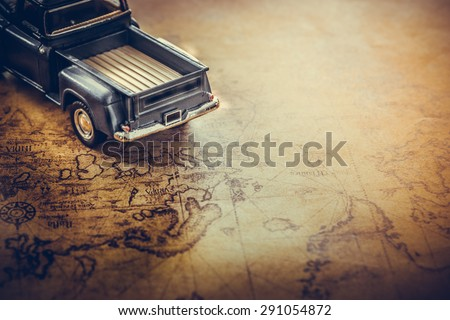 An old truck toy on a Treasure map background