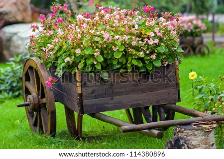 An old truck with flowers. - stock photo