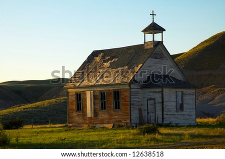 An old unused church located in the badlands of Alberta - stock photo