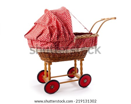 An old vintage childrens doll stroller over a white background - stock photo
