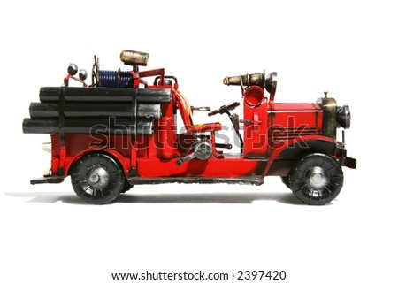 An old vintage fire truck isolated over white