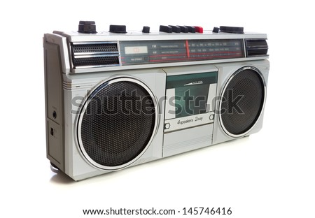 An old, vintage retro style silver boom box or radio cassette tape player - stock photo