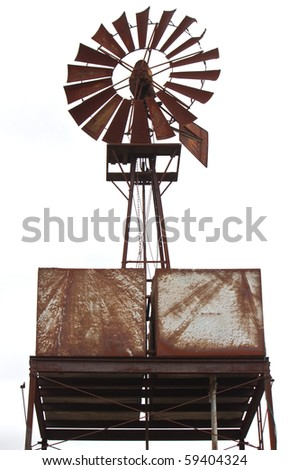 an old water windmill, rusted with age - stock photo
