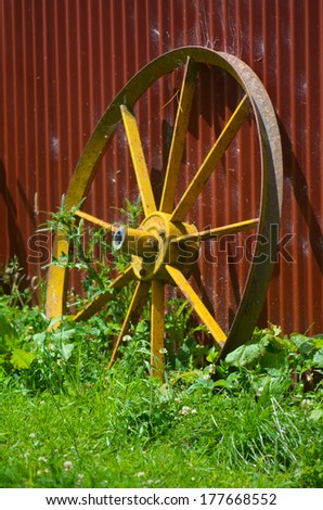An old wheel cart in deserted the farm. - stock photo