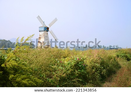 An old windmill in a field